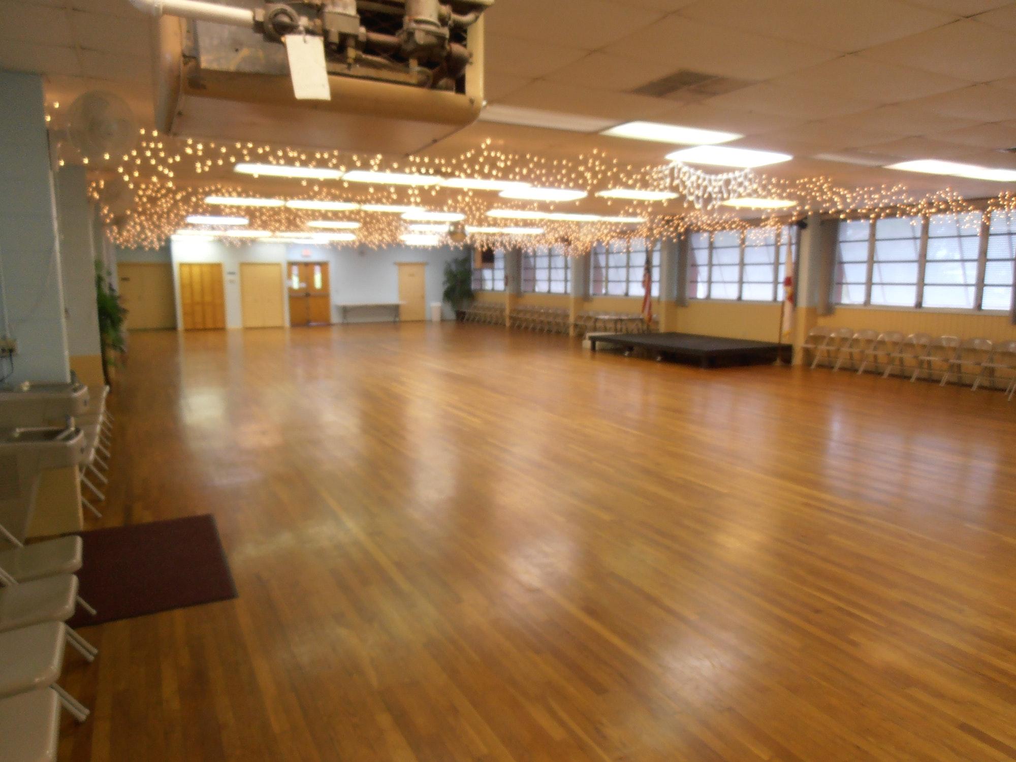 May contain: floor, indoors, room, ballroom, wood, and hardwood