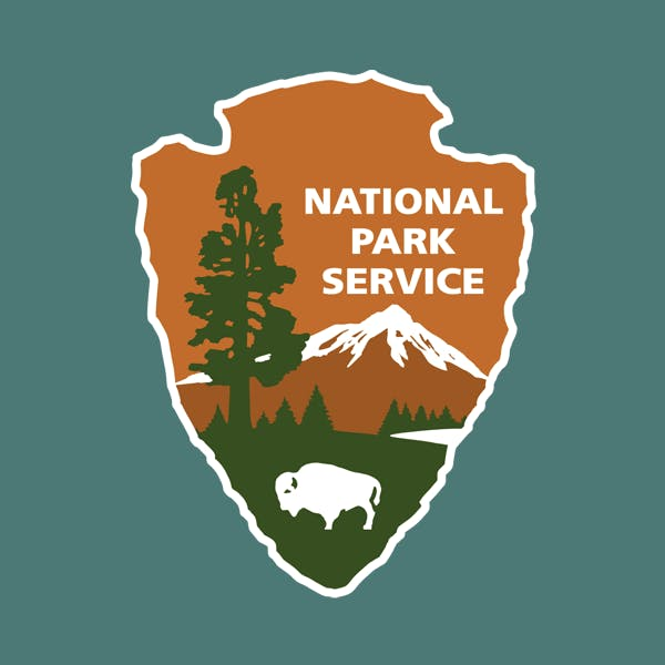National Park Service Logo with Trees, Meadows, Mountains and Buffalo