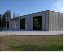 May contain: garage, building, and hangar