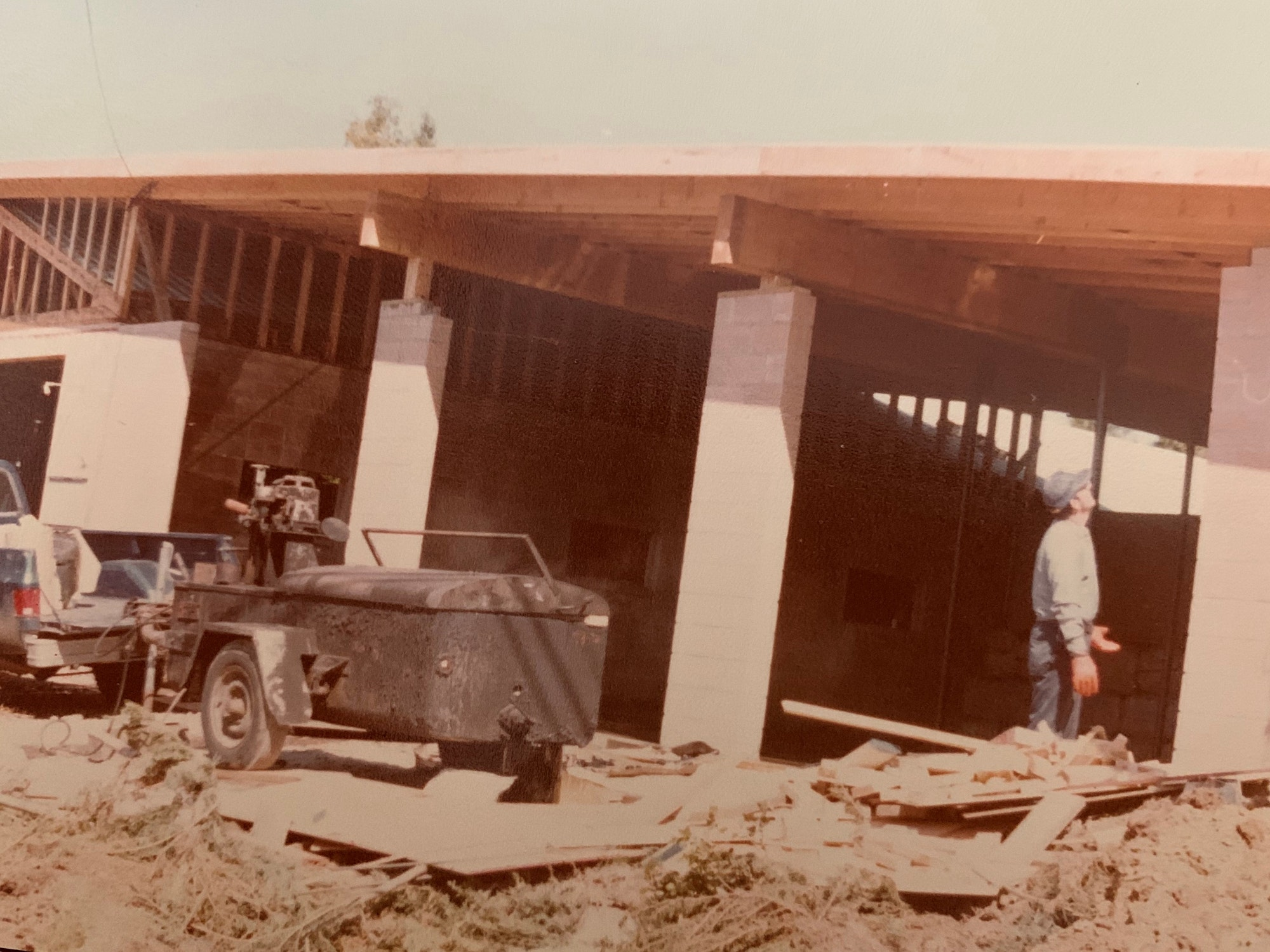Fire station under construction with person standing in front