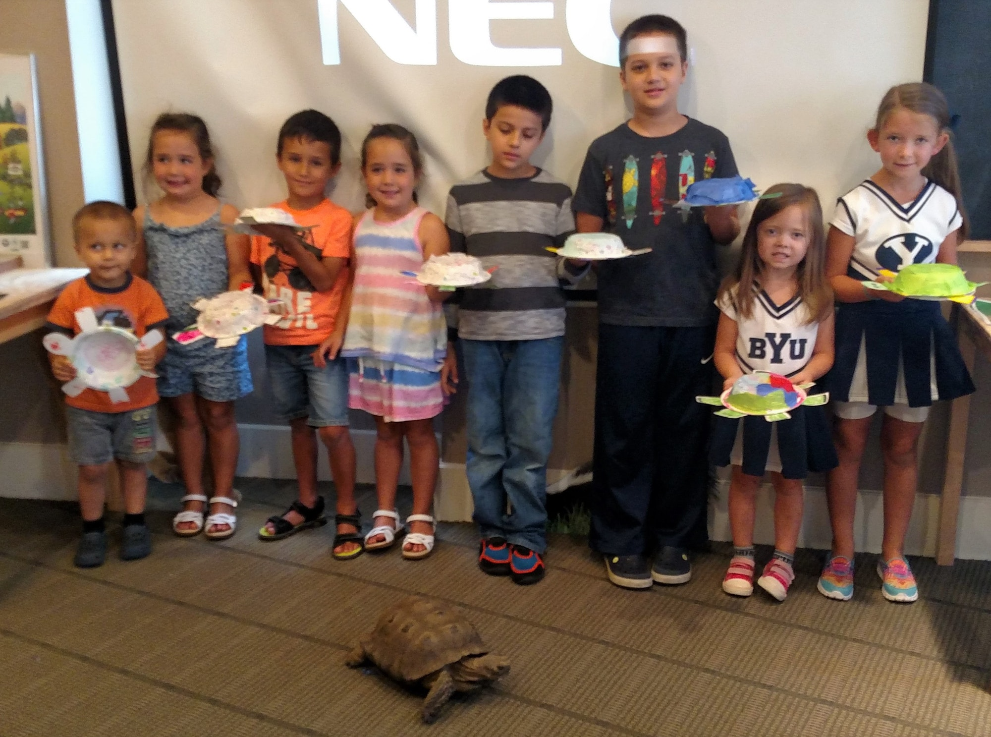 Children posing with a Desert Tortoise