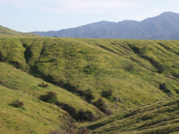 Image of green hillsides and mountains.