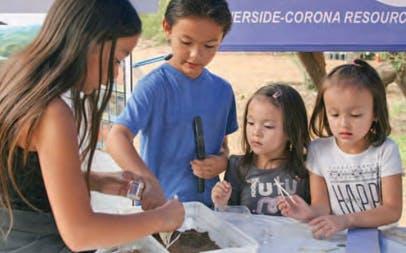 Children sampling soil texture.
