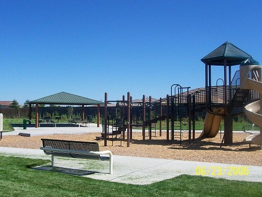 May contain: bench, furniture, plant, grass, park, outdoors, lawn, play area, and playground