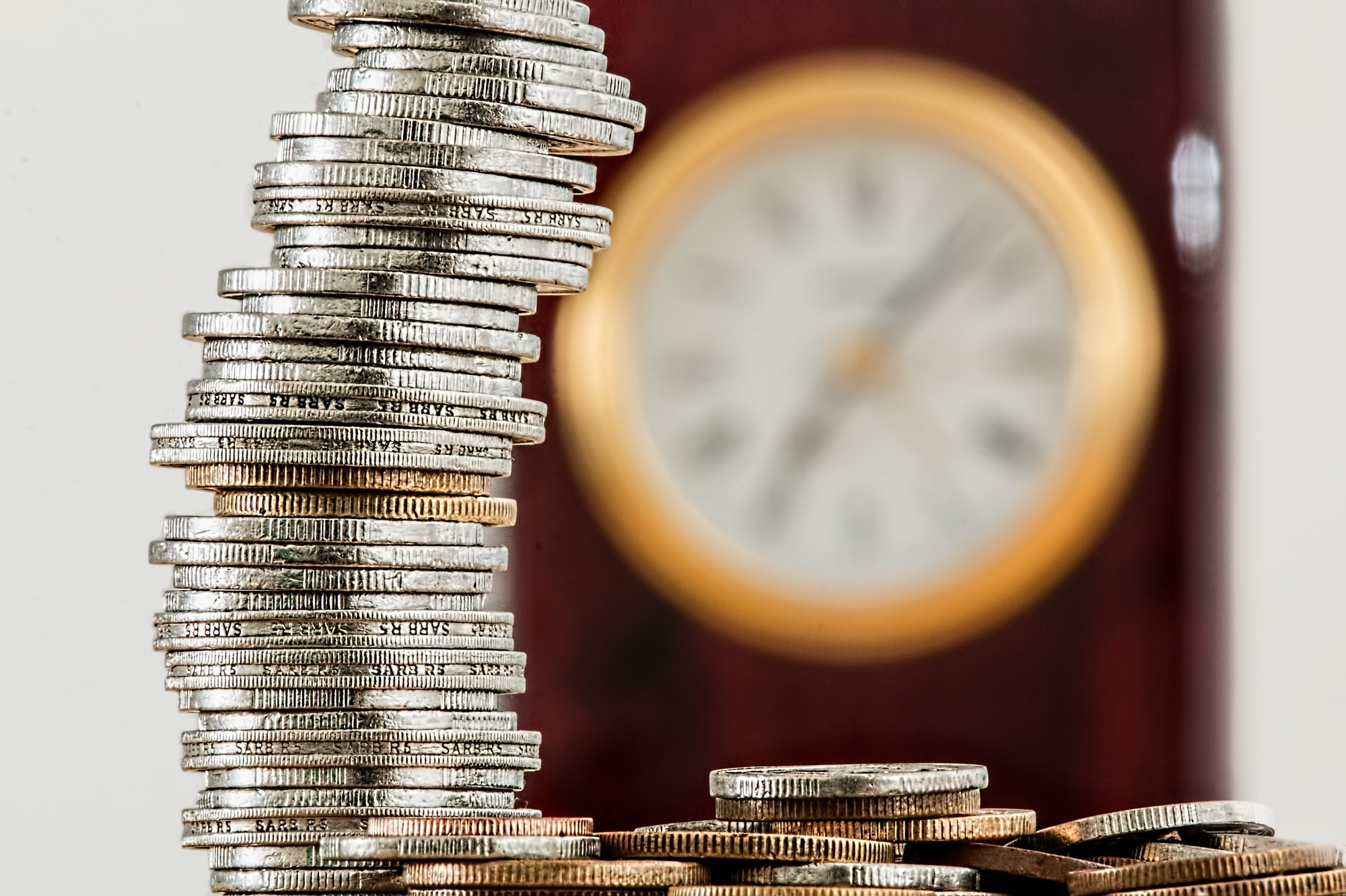 May contain: money, clock, and analog clock