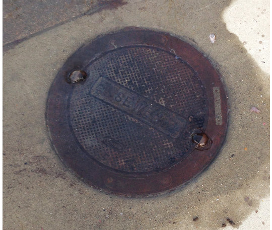 May contain: drain, sewer, hole, and manhole