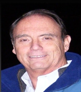 Cliff Avery in white shirt with blue jacket