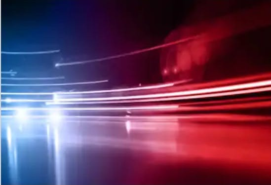 Time lapse photograph of red and blue lights from emergency vehicles