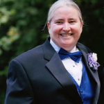 Candy McCullough in tuxedo with blue cummerbund and bow tie