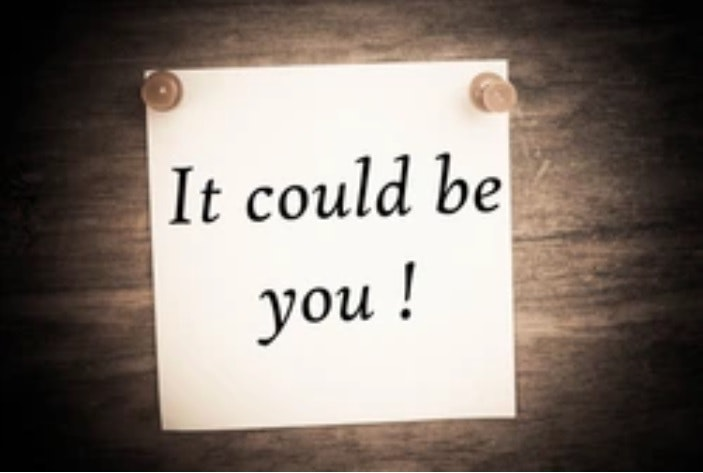 """It could be you!"" written on a note held up by push pins"