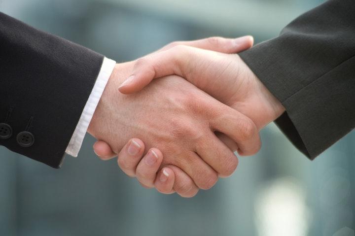 May contain: hand, human, person, and handshake