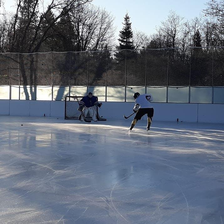 May contain: person, human, skating, rink, ice skating, sport, and sports