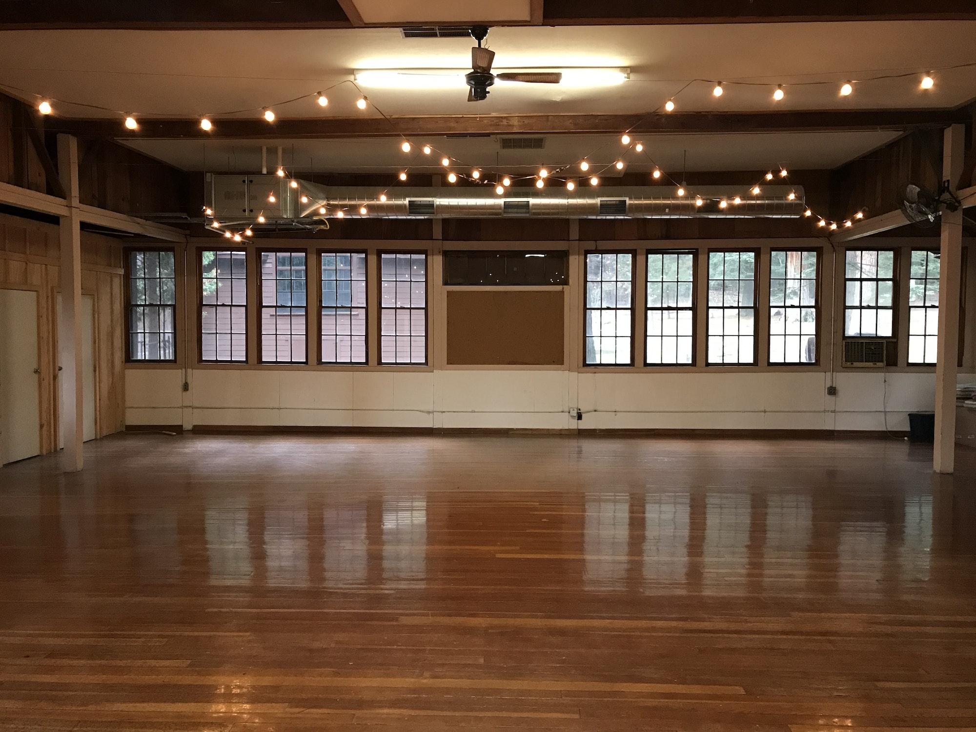 May contain: indoors, room, ballroom, floor, and wood