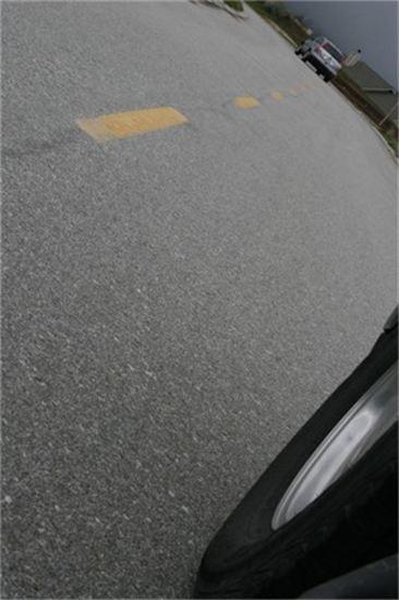 May contain: asphalt and tarmac