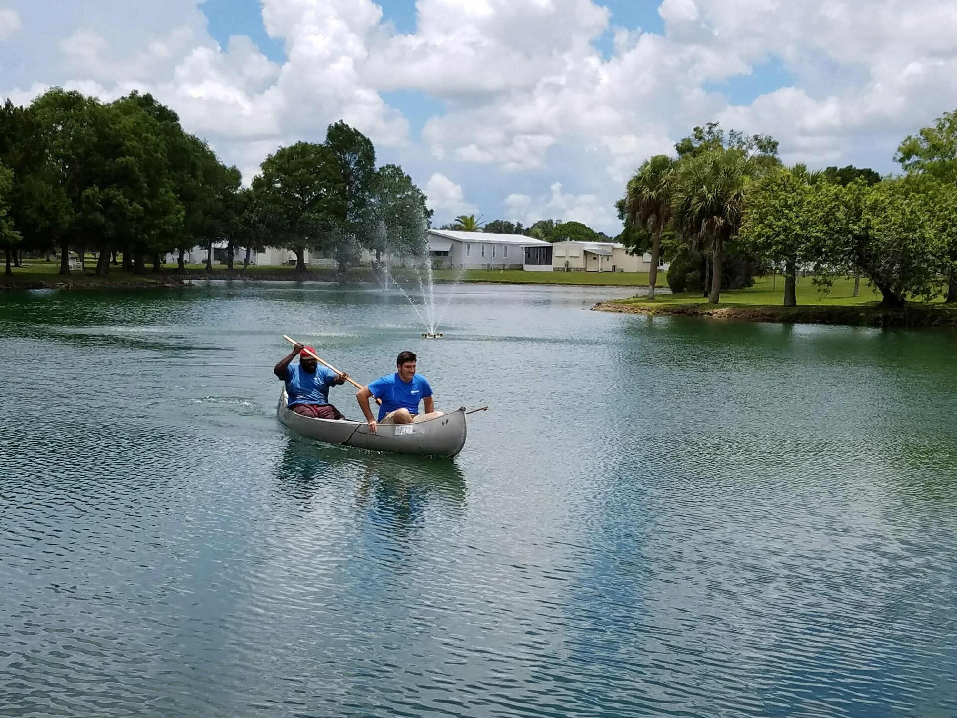 May contain: person, human, vehicle, transportation, boat, rowboat, and water