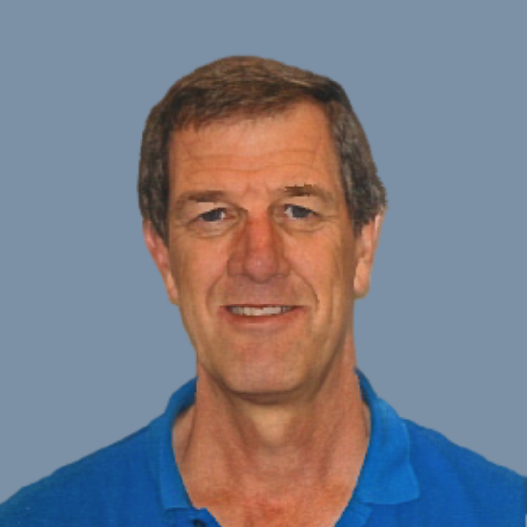 Caucasian man with brown hair wearing blue polo shirt on blue background