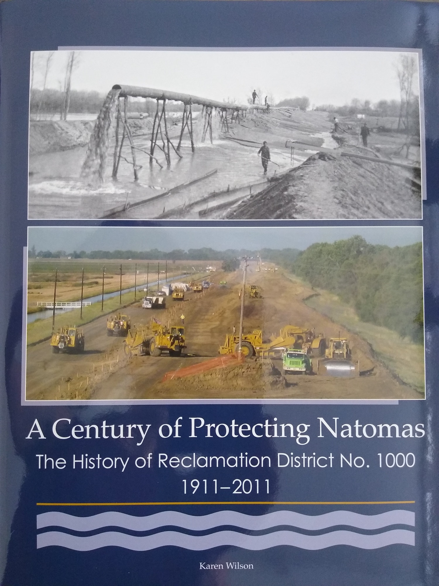 "picture of RD1000 Centennial Book cover. Navy blue cover with historical and modern day photo titled ""A Century of Protecting Natomas"""