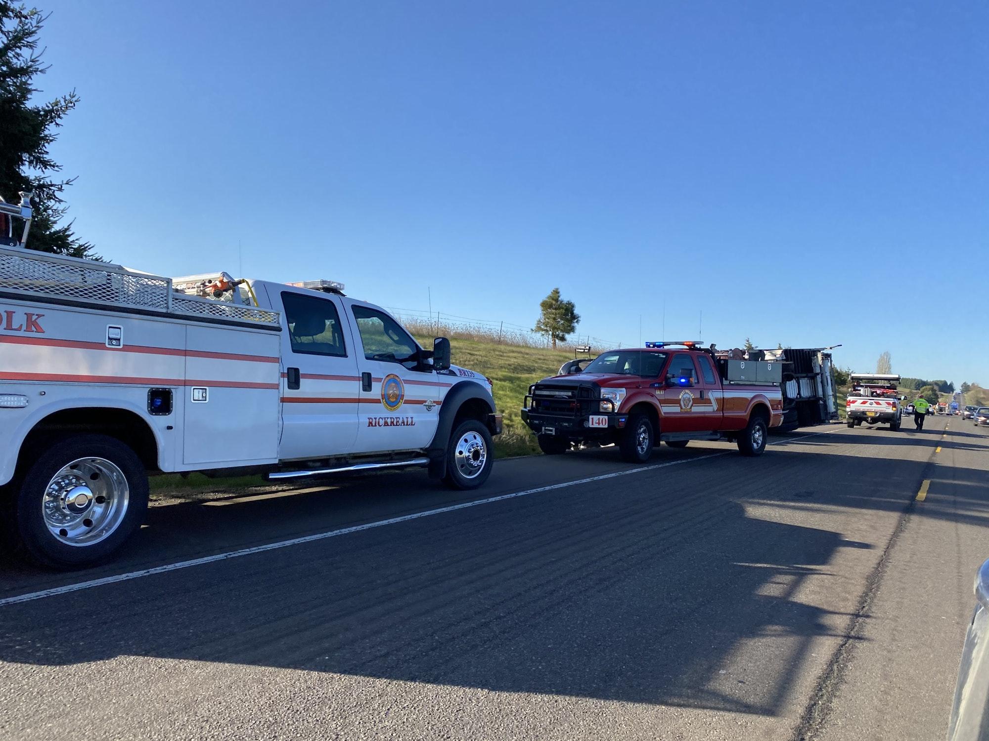 May contain: truck, transportation, vehicle, asphalt, tarmac, human, and person