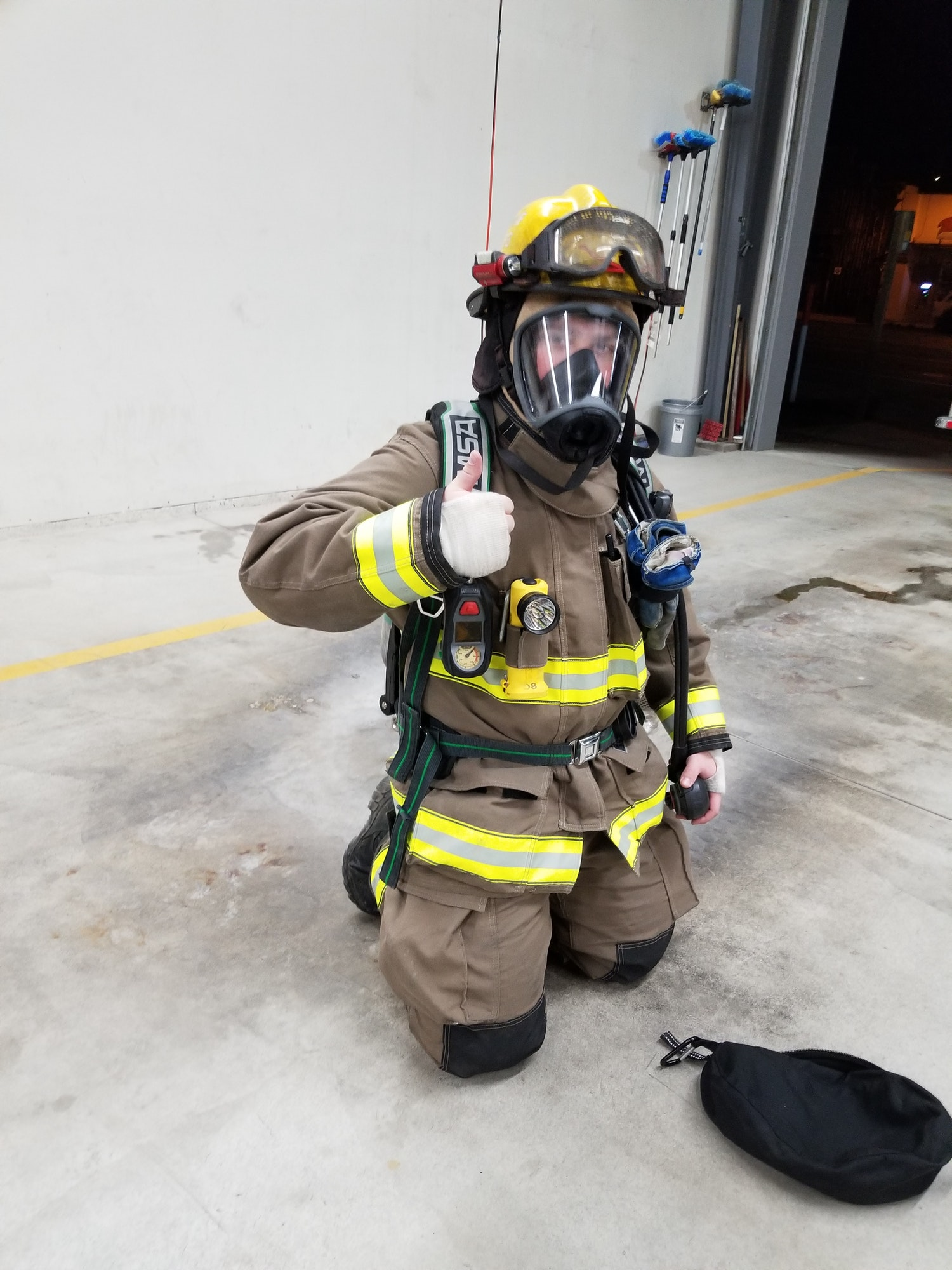 May contain: clothing, apparel, helmet, person, human, and fireman