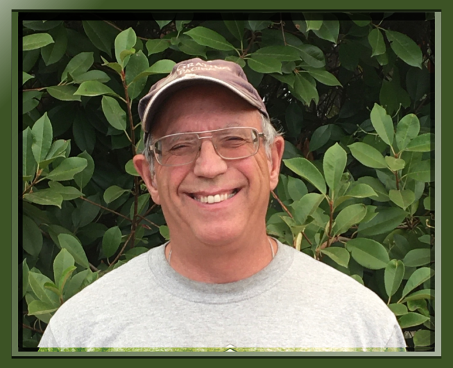 Dan Negus, Board member, male, wearing glasses and ball cap hat, person, human, and smiling face