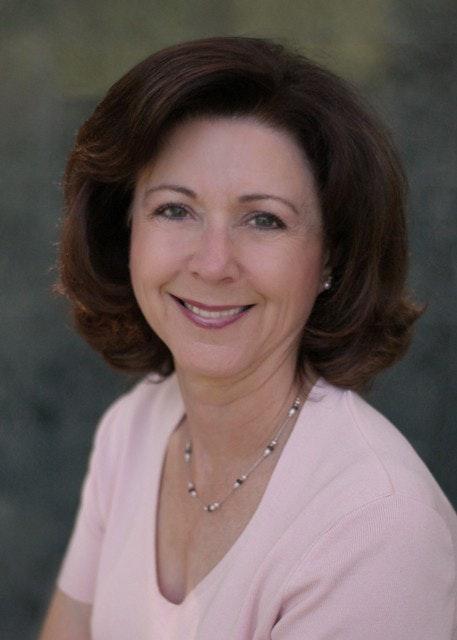 Jo Anne Carmona: person, human, face, necklace, accessory, jewelry, accessories, and female