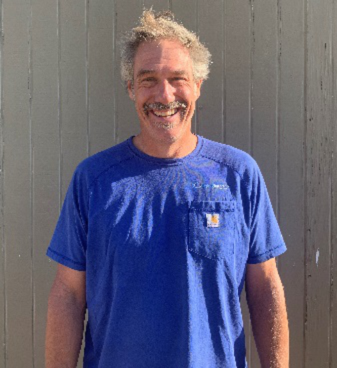 Owner Contractor: Gerry LaBudde: Wearing blue T shirt, With Hydros Engineering logo, man