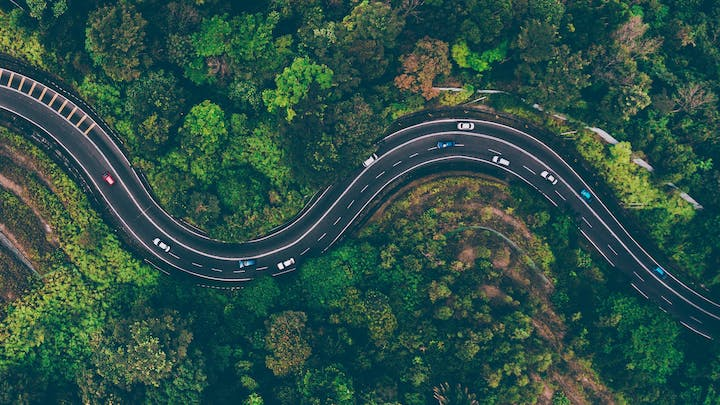 May contain: nature, outdoors, landscape, scenery, road, panoramic, aerial view, bridge, building, freeway, and highway