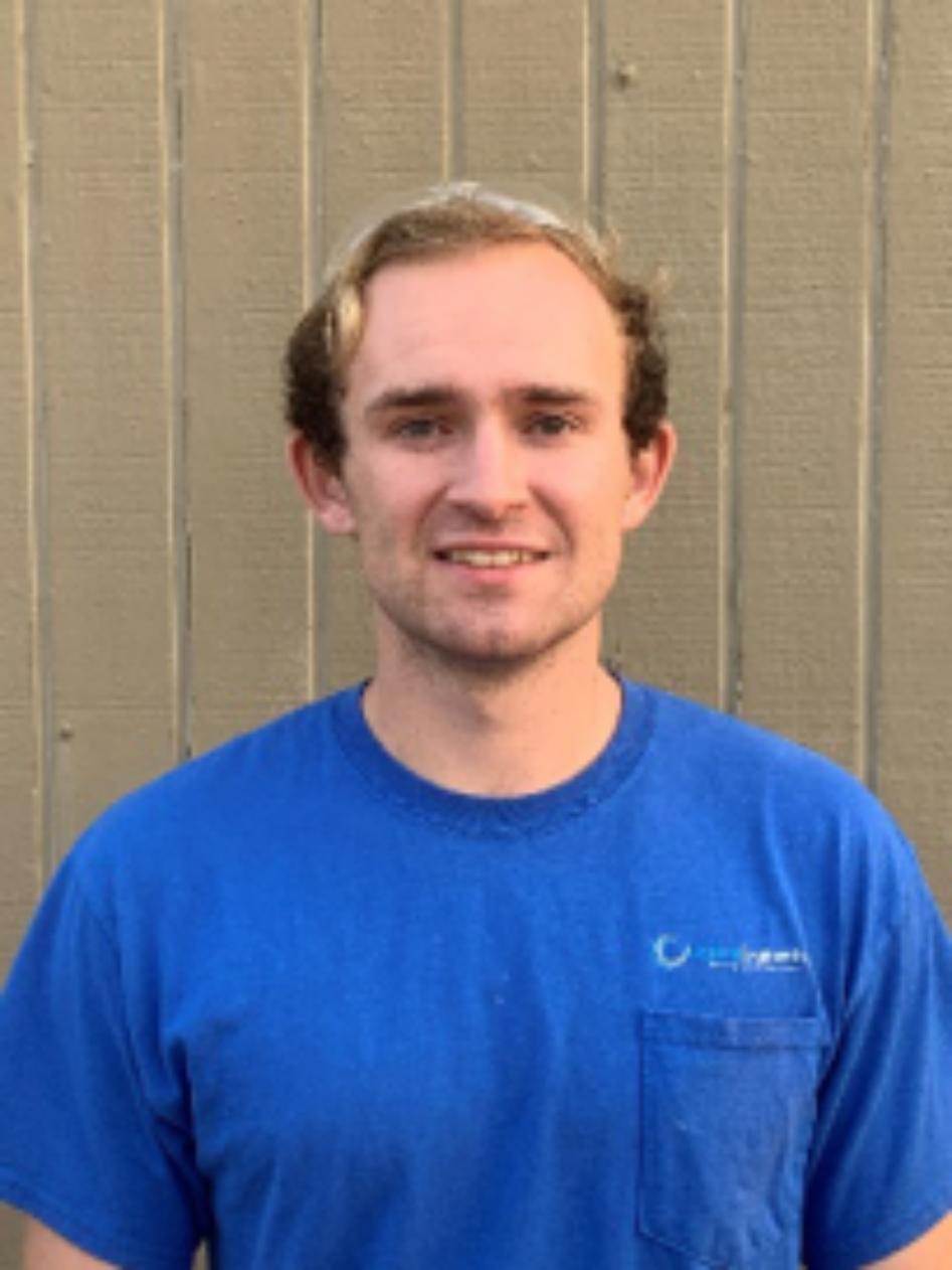 Tyler Austin, Wearing blue T shirt, With Hydros Engineering logo, man