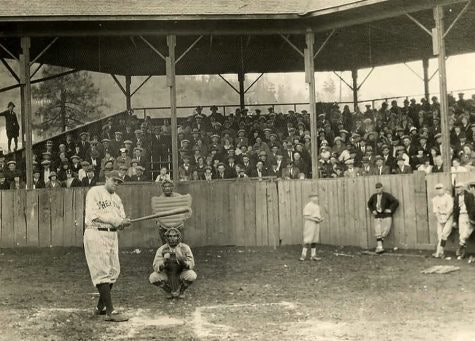 picture from pictures mound, Babe Ruth, catcher, umpire, some players in front of grand stand and full grandstand of people.