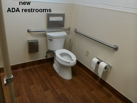 inside updated community building showing new ADA toilet in new restroom.
