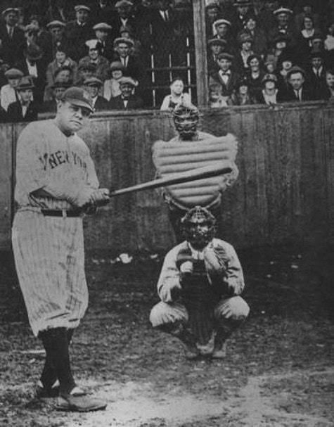 Photograph Babe Ruth at bat, catcher, umpire, looking from pictures mound. grandstand background with people in Sunday best.