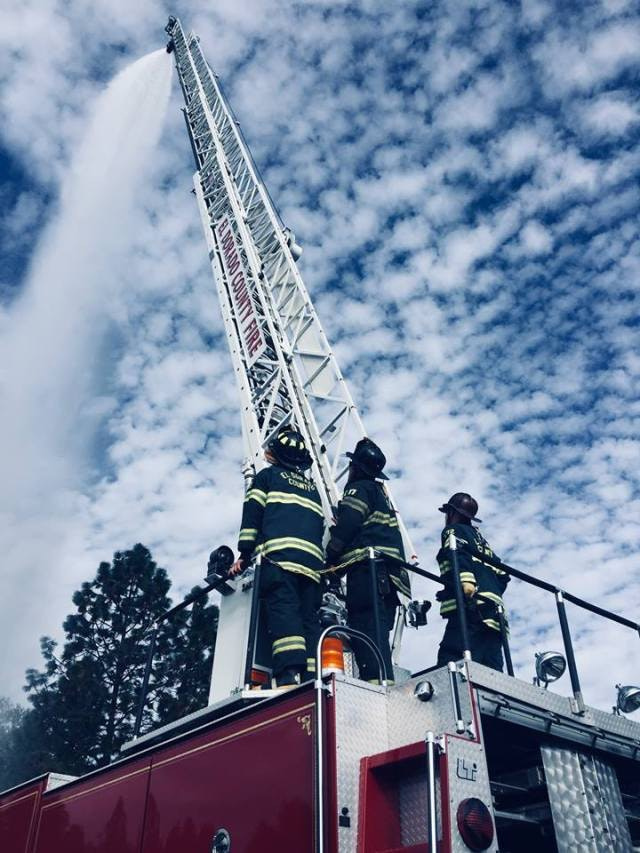 May contain: person, human, construction crane, and fireman