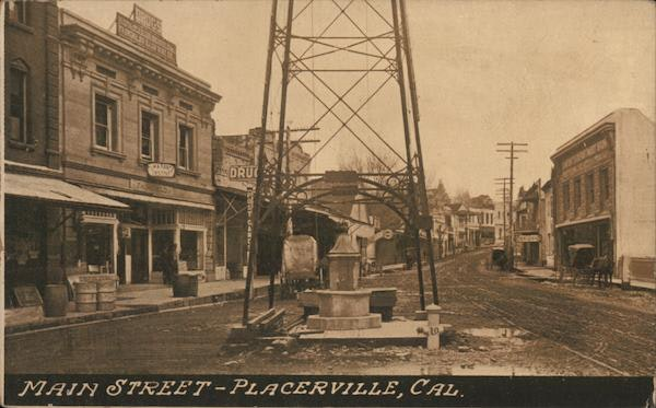 archive photo of bell tower, fountain and fire hydrant in Placerville, CA. contains dirt roads, brick buildings